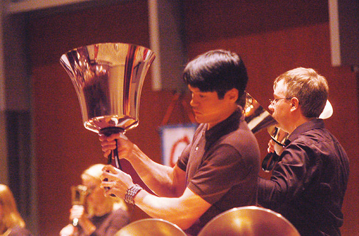 An alumni who performing bells